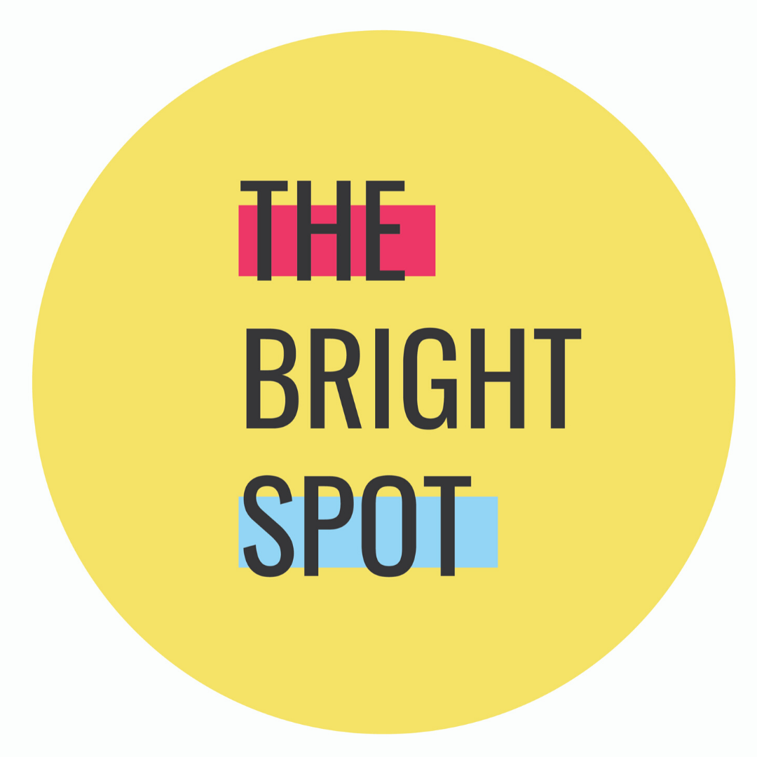 Yellow Circle with text The Bright Spot