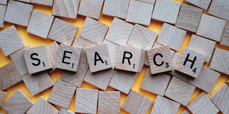 Scrabble game pieces that spell out Search